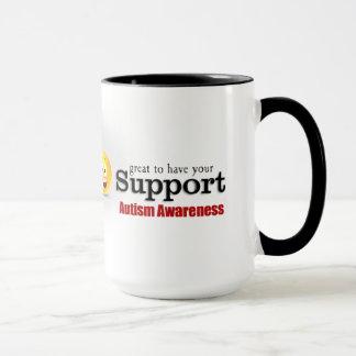 Caneca da campainha do apoio do autismo