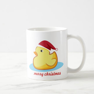 Caneca de borracha amarela do pato do Feliz Natal