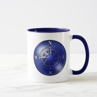 Caneca de café azul do rosa de compasso