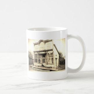 Caneca De Café Construção dos bens secos do vintage