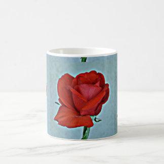 Caneca de café da rosa vermelha do sangue