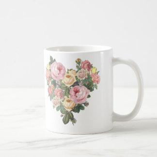 Caneca de café do coração da flor