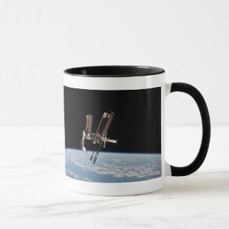 Caneca Docas da canela com a estação espacial