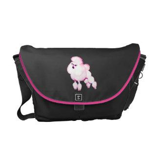 Caniche cor-de-rosa no saco do laptop do bolsa mensageiro