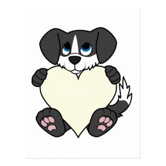 Cão preto do dia dos namorados com coração da cartão postal