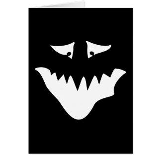 Cara assustador do monstro, no branco cartão comemorativo