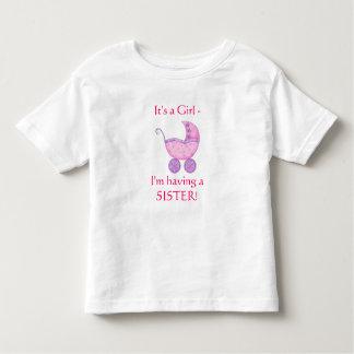 """Carrinho de bebê cor-de-rosa """"que tem criança de tshirts"""