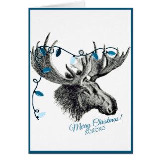 Cartão Alces parvos do Natal com luzes azuis