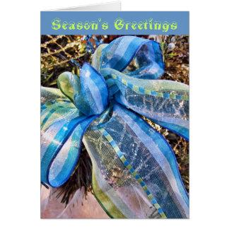 Cartão Arco azul & de prata do Natal com a festão da
