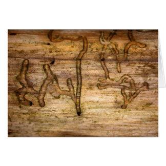 Cartão Assina dentro a madeira