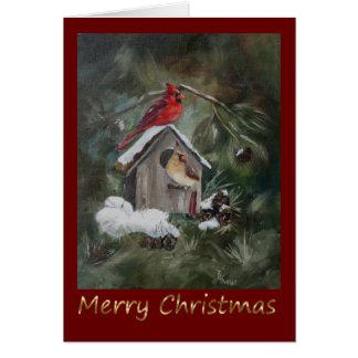 Cartão Cardeais no Birdhouse nevado
