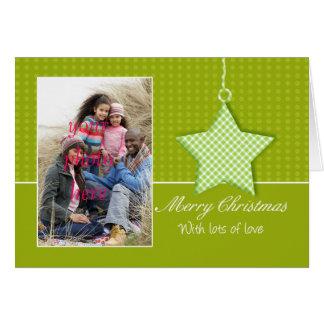 Cartão da foto do Feliz Natal com suspensão de S