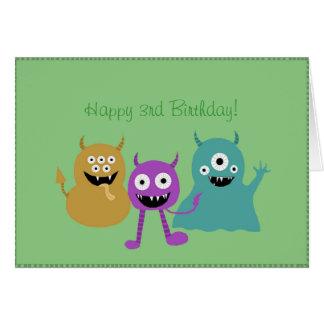 Cartão de aniversário bonito dos monstro
