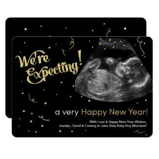 Cartão do anúncio da gravidez do feliz ano novo