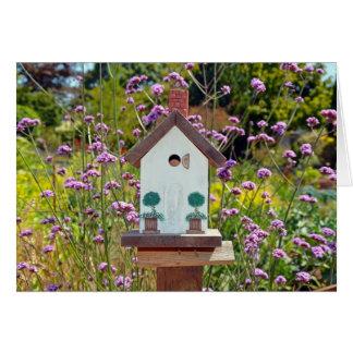 Cartão do birdhouse do jardim do primavera
