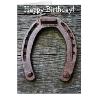 Cartão do feliz aniversario com a ferradura na
