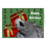 Cartão do feriado do Natal do papagaio do cinza af