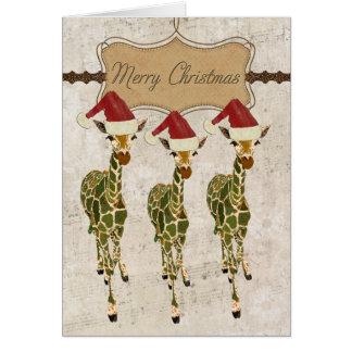 Cartão dourado festivo do Feliz Natal dos girafas
