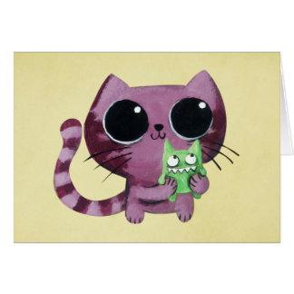 Cartão Gato bonito do gatinho com o monstro verde pequeno