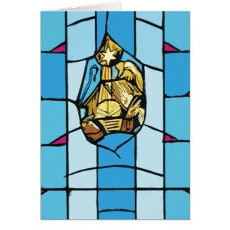 Cartão Natal azul do vitral de Noel da natividade