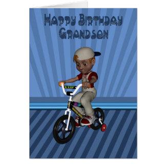 Cartão Neto do feliz aniversario, menino em uma bicicleta