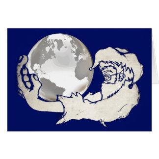 Cartão o mundo inteiro em uma mão dos macacos