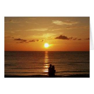 Cartão O por do sol no indiano balança a praia -