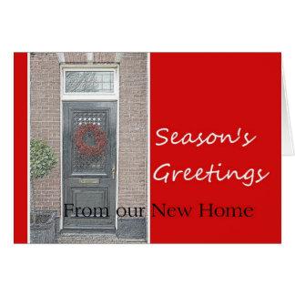Cartão Os cumprimentos da estação da casa nova