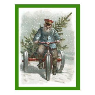 Cartão Postal Triciclo de Papai Noel que entrega a árvore de