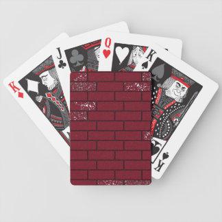 Cartões desvanecidos dos tijolos cartas de baralho