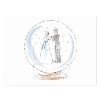 Casal do casamento do globo da neve cartão postal