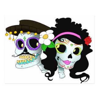 Casal festivo mexicano do crânio