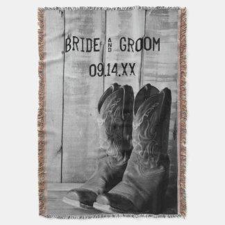 Casamento ocidental rústico das botas de vaqueiro manta