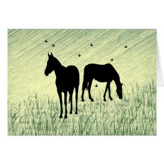 Cavalos no campo cartão comemorativo