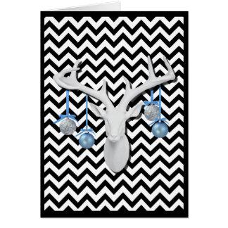 Cervos brancos com os ornamento azuis no feriado cartão comemorativo