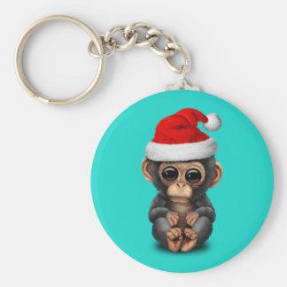 Chaveiro Chimpanzé do bebê que veste um chapéu do papai