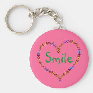 Chaveiro do sorriso com coração fora das borboleta