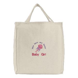 Chocalho do bebê - rosa bolsas bordadas