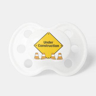 Chupeta Sob a construção com cones