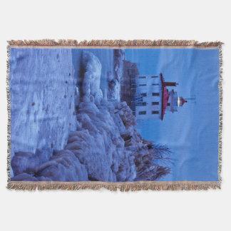 Cobertor Noite invernal, gelada no farol do porto de