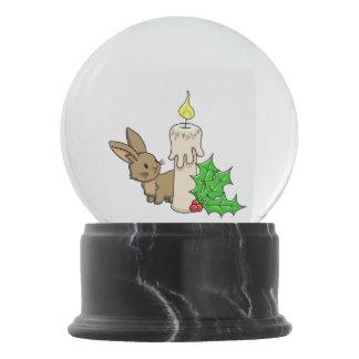 Coelho com uma vela do Natal