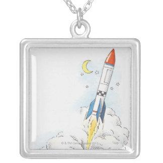 Colar Banhado A Prata Ilustração de uma descolagem do foguete