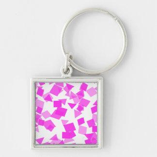 Confetes cor-de-rosa brilhantes no branco chaveiro quadrado na cor prata