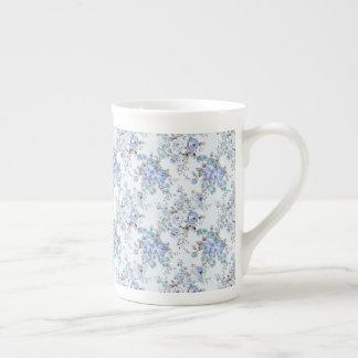 Copo de chá rosado azul do teste padrão de flor xícara de chá