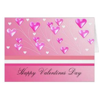 Corações cor-de-rosa de flutuação dos namorados cartão comemorativo
