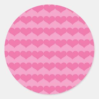 Corações cor-de-rosa no rosa adesivo