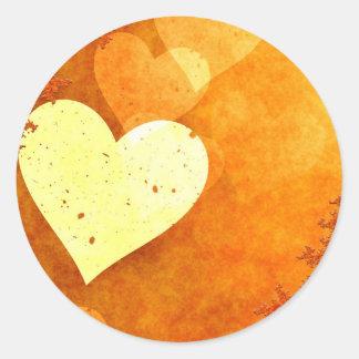 Corações de flutuação alaranjados e amarelos adesivo