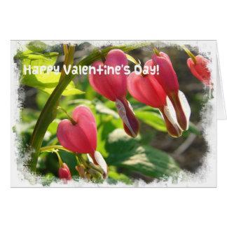 Corações de sangramento dos namorados cartão comemorativo