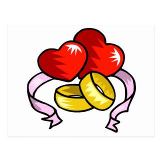 Corações e alianças de casamento do casamento cartão postal