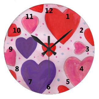 Corações roxos e vermelhos cor-de-rosa do dia dos relógios para paredes